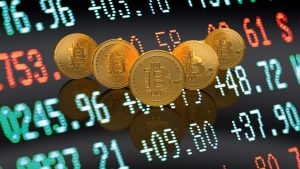 Five physical Bitcoins in a V formation hovering over a digital screen with asset prices